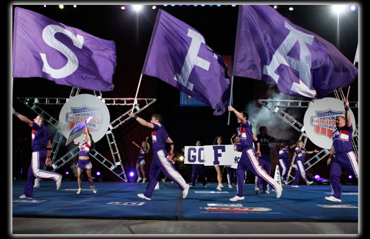 SFA cheerleaders and flags