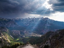"Sunlight beams through stormy clouds, as seen from the top of the Amphitheater far above the town of <a href=""search.php?q=ouray"">Ouray</a>, Colorado. A strange thing... as I was standing here 5,000 feet above town, I could hear a band playing way down there!"